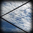 Clouds seen from behind wire grid